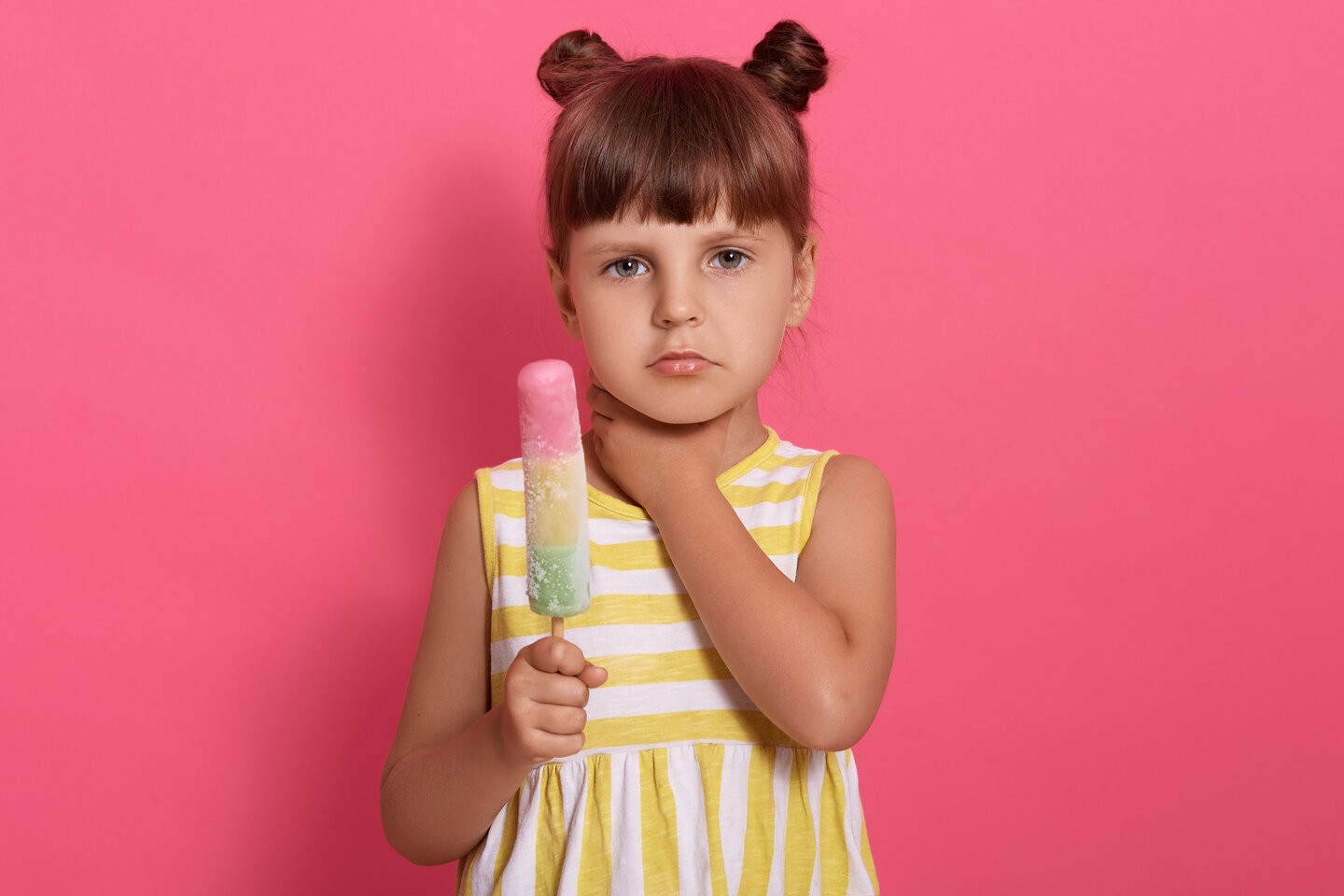 rsz cute little girl eating ice cream and has sore throat