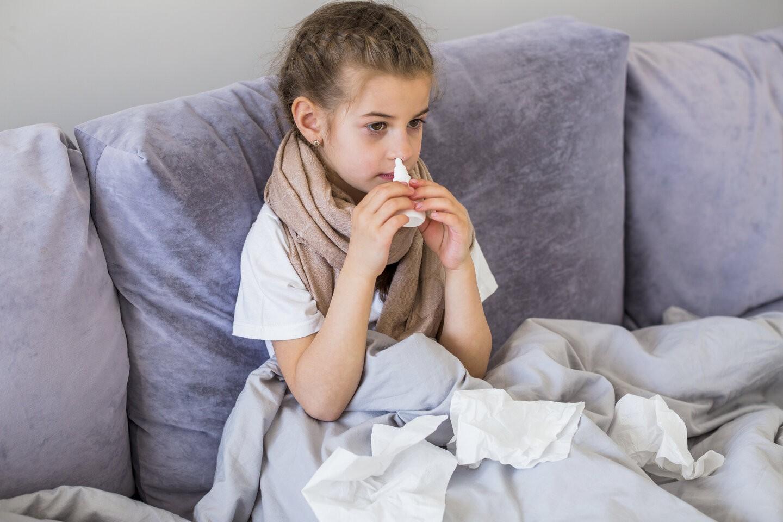 rsz little girl using nose spray