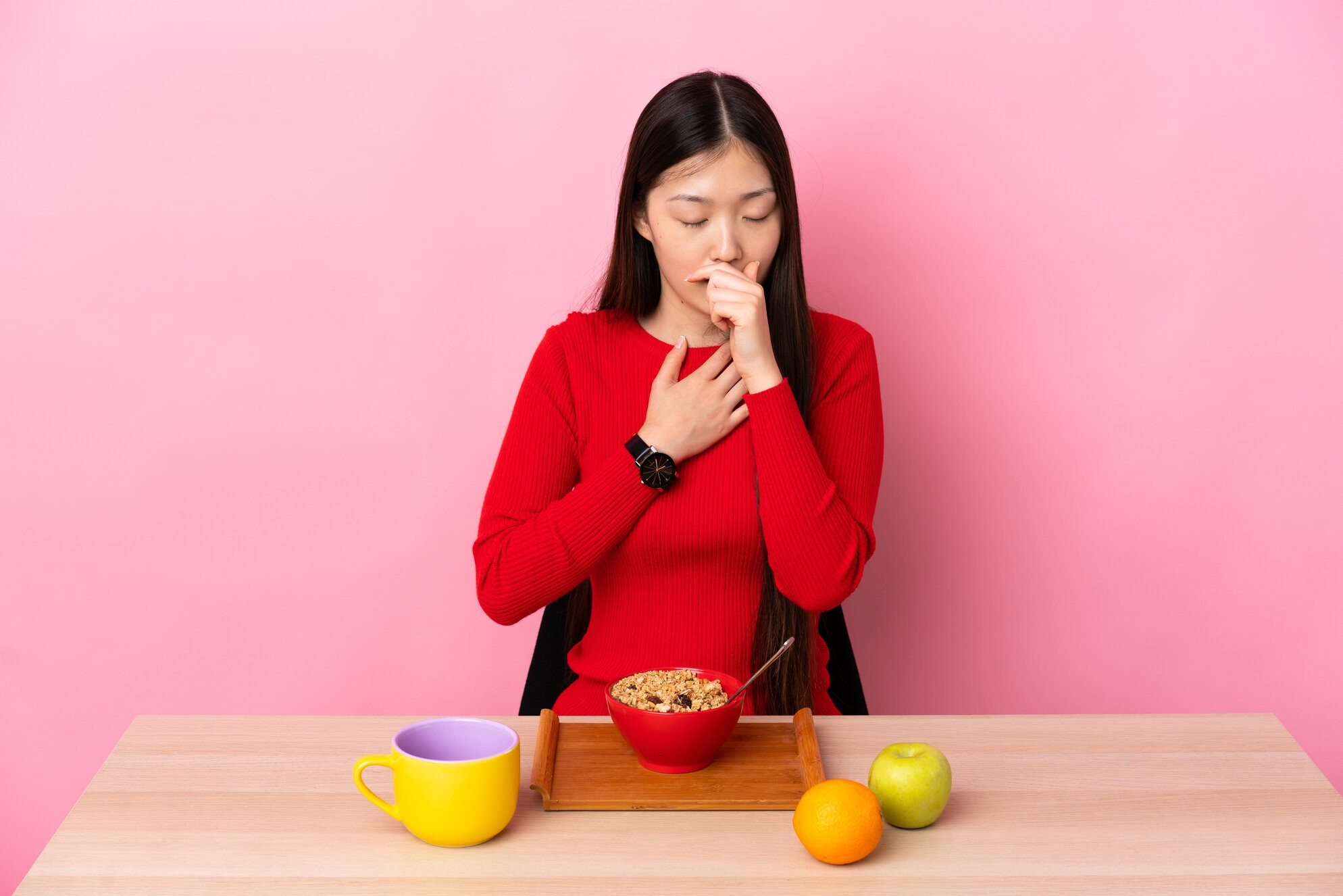 rsz young chinese girl having breakfast table coughing lot